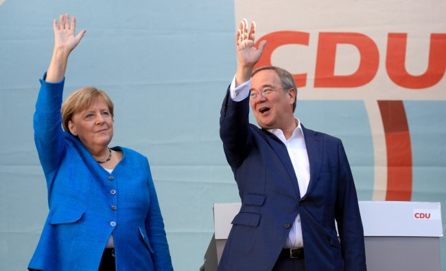 German Chancellor Merkel and CDU party leader and candidate for chancellor Laschet attend a rally, in Aachen. Credit: Reuters Photo