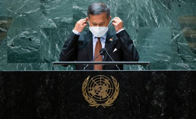 Foreign Minister of Singapore Vivian Balakrishnan removes his protective face mask before addressing the 76th session of the United Nations General Assembly at UN headquarters. Credit: AFP Photo