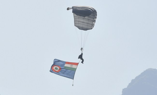 Team members opened their parachutes and displayed various formations, the Indian national flag, the IAF flag, and the Akash Ganga flag rippled in the sky. Credit: PTI Photo