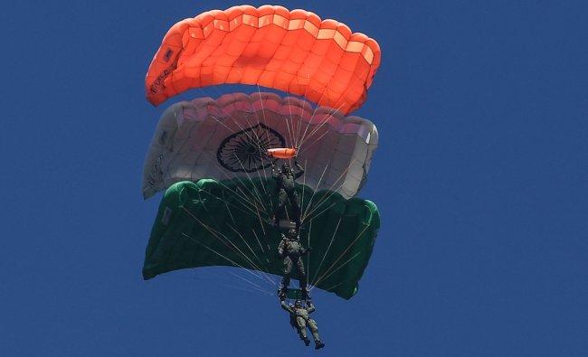 The IAF\'s Akash Ganga skydiving and Suryakiran Aerobatic Display teams took part in it. Credit: AFP Photo