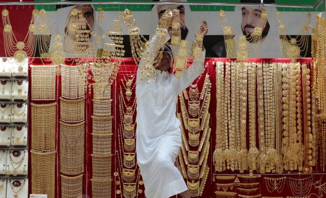 An employee arranges jewellery in a shop at the Gold Souq in Dubai