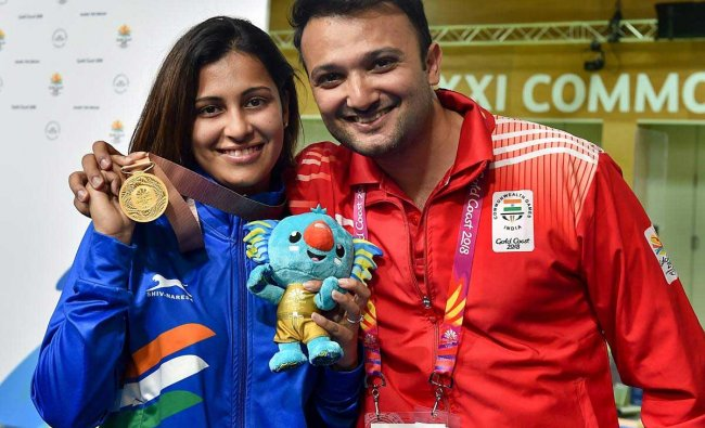 Indian shooter Heena Sidhu with her husband and coach Ronak Pandit after winning a gold medal in the Women's 25m Pistol final event during the Commonwealth Games 2018, at the Belmont Shooting Centre in Brisbane on Tuesday. PTI Photo