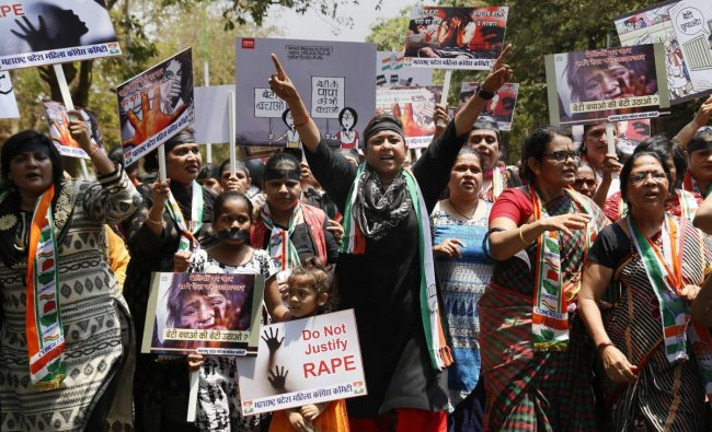 Maharashtra Congress women shout slogans during the protest against Unnao and Kathua rape cases in Thane, Mumbai on Tuesday. PTI