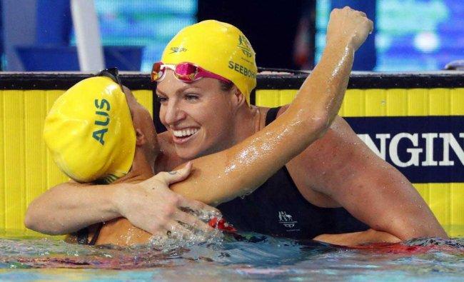 Swimming: Emily Seebohm and Holly Barratt of Australia hug. Reuters Photo