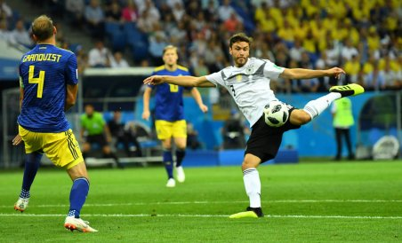 Germany's Jonas Hector in action with Sweden's Andreas Granqvist. Reuters photo.