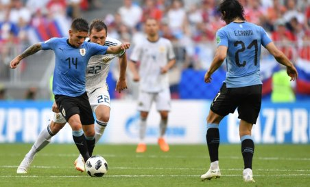 Uruguay's midfielder Lucas Torreira challenges Russia's forward Artem Dzyuba (back L) next to Uruguay's forward Edinson Cavani (R) during the Russia 2018 World Cup Group A football match between Uruguay and Russia at the Samara Arena in Samara on June 25,