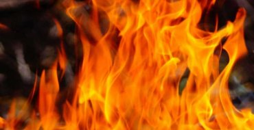 Man sets mother on fire over money