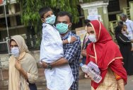 People wear safety masks as a precautionary measure after the 'Nipah' virus outbreak, at Kozhikode Medical College, in Kerala, on Friday. PTI Photo