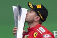 Flawless Vettel clinches 50th win