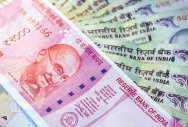Rupee sinks to record low vs US dollar