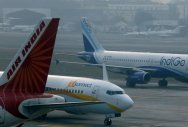 An IndiGo Airlines Airbust A320 aircraft and JetKonnect Boeing 737 aircraft taxi past an Air India Airbus A321 aircraft at Mumbai's Chhatrapathi Shivaji International Airport. REUTERS