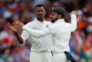 India's Hardik Pandya celebrates with Virat Kohli after taking the wicket of England's Adil Rashid. (Reuters)