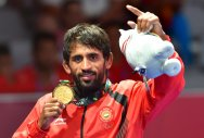 Bajrang Punia poses with his gold medal after winning the men's freestyle wrestling (65kg) final against Japan's Daichi Takatani at the Asian Games in Jakarta on Sunday. PTI