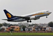 Cash-strapped Jet Airways reports Rs 1,323 cr net loss