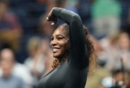 Serena surges into second round