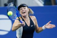 Djokovic, Sharapova progress