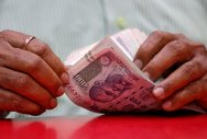 Rupee drops to fresh record low of 71.79 against USD