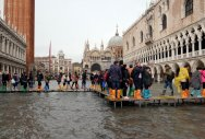 3 dead as storms lash Italy leaving Venice afloat