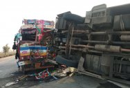 6 killed, 21 injured in bus-truck collision