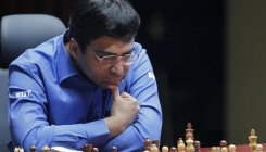 Anand defeats Karjakin, claims second spot