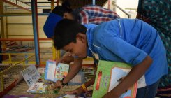 Volunteers make reading a fun activity for children