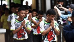Thai cave boys pray for luck after first night home