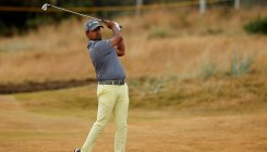 Lahiri tied 7th after flying start, Woods 14th