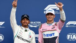 Hamilton snatches pole in rain-hit qualifying