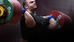 Giant Behdad completes weightlifting hat-trick