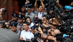 Myanmar defends Suu Kyi's silence over jailed reporters