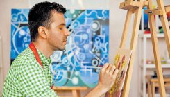 Boy, who had cataract surgery, now a painter