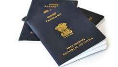 Passport official shunted out for humiliating couple