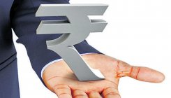 Rupee gains 6 paise against US dollar