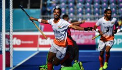 India launch title defence with 11-0 win over Oman