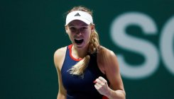 Wozniacki back on track with win over Kvitova