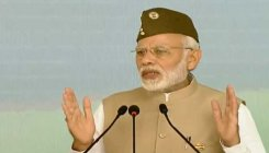 Have been walking the path shown by Netaji: Modi
