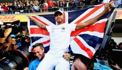 Hamilton joins Fangio with fifth title