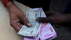 In biggest single-day gain in 5 yrs, Re gains 100 paise