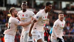 Gray lifts Leicester; United win