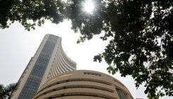 Sensex drops 61 pts on negative global cues, Re
