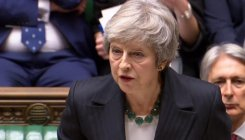British PM battles for survival over Brexit deal