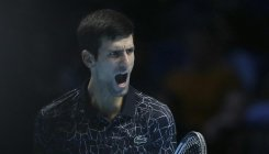 Djokovic sets up title clash with Zverev
