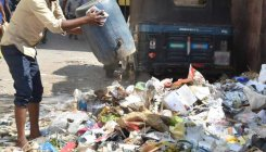 Students protest garbage dumping in front of school