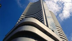 Sensex logs 1st gain in four sessions