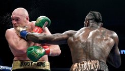 Wilder keeps title after controversial draw with Fury