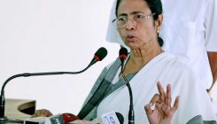 Mamata hails BJP's setback, mum on Congress' success