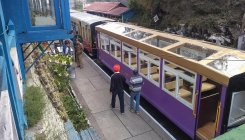 Glass-roof train chugs off on UNESCO heritage track