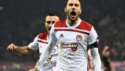 Olympiakos send AC Milan packing