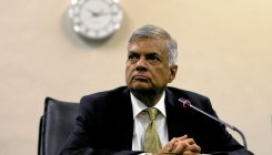 Sri Lanka reinstates ousted prime minister: official