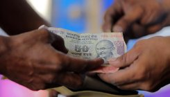 DH Poll: Most analysts see Rupee around 71 by March